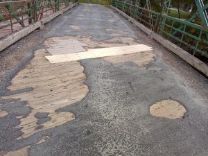 Mill Village Bridge surface needs repair